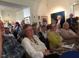 Auction room of bidders